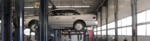 Car on the hoist being tested and inspected